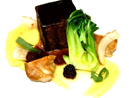 -Braised ox tail served with a pan-fried veal sweat bread, fresh black berries and snaps, braising jus.