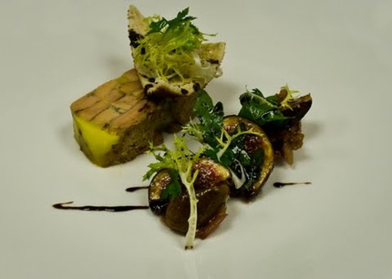 -Foie gras terrine served with a figs jam, toast bread melba, and salad of frisse and rocket.