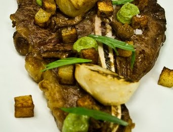 -Grill T-bone steak, served with salt baked celeriac, pickle wild mushroom, fried rissole potato, Tarragon emulsion, pluck tarragon and Tomato béarnaise sauce.