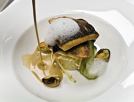 -Pan-fried sea bass served on del Monaco potato mussel-creamed volute, salad of Pickled root vegetables julienne marinade apple vinegar topped with herbs salad, butter fried pakchoy leaves.