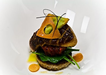 -Pan-fried foie gras served with a fried brioche, caramelize fresh orange, salad of baby spinach, confit orange skin, reduction of sauterne and vanilla syrup, avocado pure.