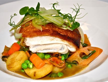 -Pan-fried lemon sole coated with thin slice of toast bread serve with new potato, sauce nage (celeriac juice reduce down with mussel marinière jus mounted butter), (blanche carrots, peas, salturt, pluck mussels), pluck peas shots, chop ramsløg and celery crudity.