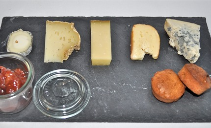 -French cheeses: served with quince marmalade mix with chrismas spices dry fruits, hazelnuts brioche.