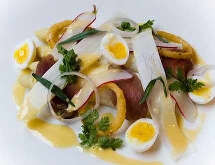 -White asparagus with salted pork tenderloin, quail egg and nage of smoked cheese.