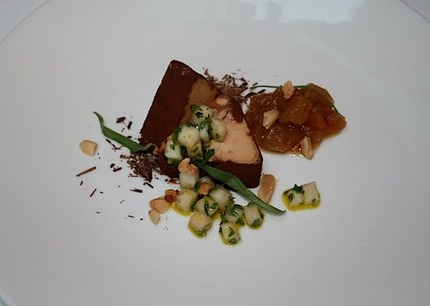 -Foie gras snickers terrin m/ peanuts, salted caramel, peanuts, coated coco powder and served with a yellow beetroot chutney, olive oil, estrogen and fresh dices pear vinegrette.
