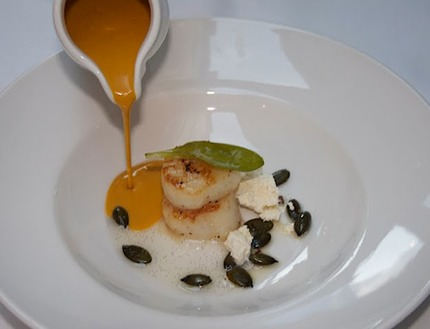 -Pan-fried scallops served with a pumking and cardamon soup, vanilla oil Malto crumble, and a pluck oyster leave.