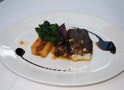 -Roasted cod with a black olive crust, sauteed green cabbage, chorizo pomme hanna, balsamic reduction.