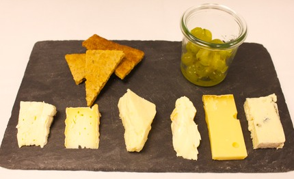 Unika cheeses with pickled gooseberries and rye cracker.