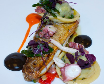 -Pan fry sea bass served with ratatouille, ravioli of spinach, pins, Parmesan cheeses, and slice marinated black sprout, ink mayonnaise, pluck red cress & saltwort.