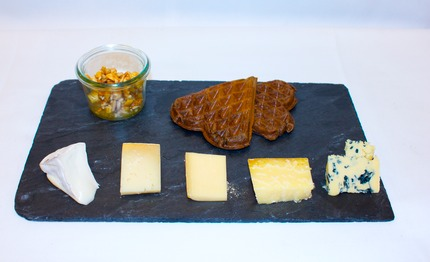 -Danish cheeses served with a malt waffle, honey nuts marmalade.