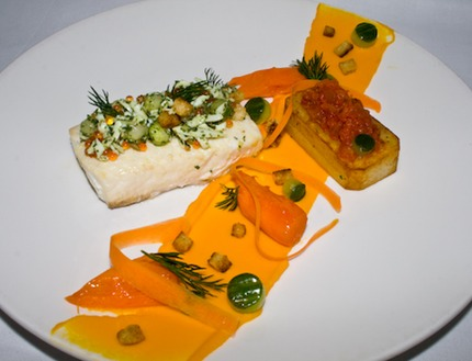 -Bake halibut served with carrots puree and pickle carrots heart, salad of grated eggs white, small dice crouton, chop shallots onion, dill, mix with butter, cucumber bolls, confit potato in rasp oil and thyme, rosemary garlic.