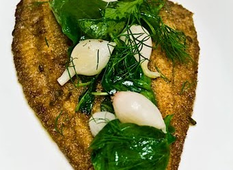 -Butter-fried plaice served with fried spinach, pickle Pearl onion and pluck dill (chop dill and shallots served with the new potato).(served in oval plate).