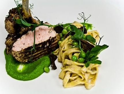 -Grill pork cutlet served with peas pure and fresh peas, liquorice crumble, and creamed morale sauce, fresh home made tagliatelle pluck peas shoots.