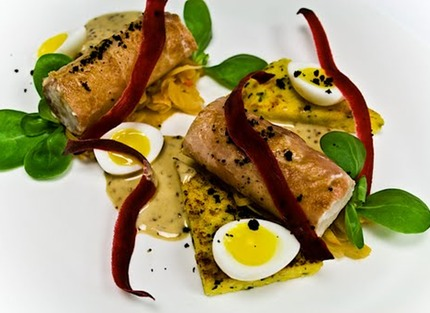 -Ballotine of cod wrapped in Parma ham served with fried tarragon polenta, poched quaile eggs with yolkes (smiling), marinade fennel and chilli jam, fried cod skin and sautéed portulack.(served in oval plate).